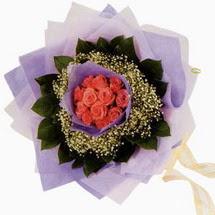 12 adet gül ve elyaflardan   Siirt çiçek gönderme sitemiz güvenlidir